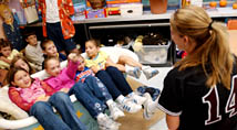 EKU softball player does storytime with model elementary students